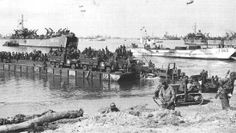 Scene showing trucks and the staff of the US Army first being brought to the ground by means of a Rhino Ferry. Rhino Ferries and tugboats, operated by the US Navy Construction Battalion (CB-construction battalion) personal operated the artificial Mulberry Harbour at Omaha Beach in Normandy