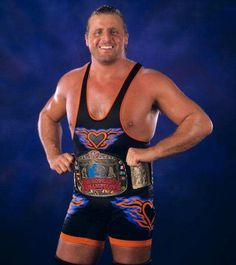 """WWF wrestler Owen Hart passed away on May 1999 during """"Over the Edge,"""" a pay-per-view event. Hart was performing a stunt involving a safety harness that failed, causing the Canadian wrestler to fall 78 feet, bouncing chest first off the top rope. Catch Wrestling, Wrestling Wwe, Wrestling Rules, Celebrities Who Died, Celebrity Deaths, Wrestling Superstars, Combat Sport, Wwe Wrestlers, Professional Wrestling"""