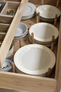 Brilliant use for deep kitchen drawers--plate storage that's neat and easy to reach!