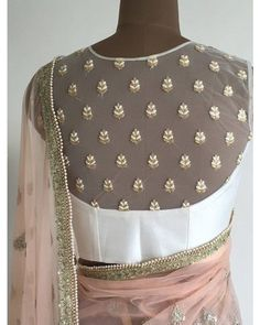 Looking for blouse designs photos? Here are our picks of 30 trending saree blouse models that will blow your mind. Blouse Back Neck Designs, White Blouse Designs, Netted Blouse Designs, Saree Blouse Designs, Saree Blouse Models, Net Saree Blouse, White Saree Blouse, Sari Design, Design Net