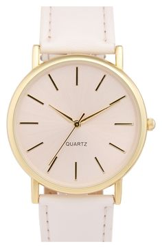 Adore the simplicity of this pastel pink and gold watch.