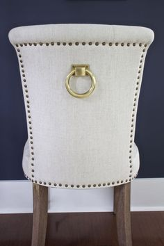 New Dining Room Chairs. Dining chairs with brass accents. Dining chairs with nailhead trim. Dining chairs with tufted chair backs. Dining chairs with brass accents.