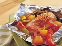 Grilled Sweet-and-Sour Chicken Packs  This is definitely something I have to try on my camping trip in July!  Would also be great to cook on the fire at Oshkosh for all you campers out there.