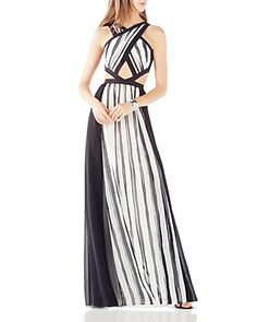 Strut your stuff in a black and white BCBGMAZAZRIA floor-length striped cutout gown.