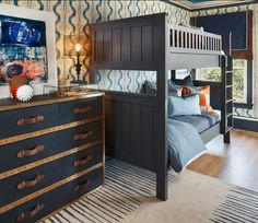 Navy blue boys bunk room by Shelley & Co. featuring our Lash Rug and Wainscott Oxford Weave Bedding. #serenaandlily