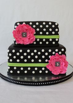 Black Cake with white polka dots and pink flowers...