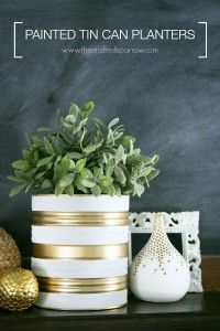 painted tin can -- make similar to this one.. add in some black, maybe do some solid gold, and/or add in bright geometric shapes. -- fill with fresh flowers/leaves/branches - OR could use larger ones (like on in pic) to hold ice + beverage bottle !