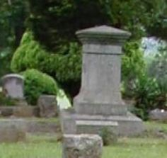 Close up of the little girl ghost at Cedar Hill Cemetery in Scottsboro, AL: Cedar Hill Cemetery is a huge 67 acre cemetery located in Scottsboro Alabama on May 3rd, 2003. In the oldest part of this cemetery, I was strolling through,