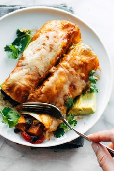 Easy Veggie Enchiladas! Saucy, cheese, filling, cozy, and packed with any roasted veggies you want. Super versatile and easy to make!