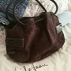 Brown Suede and Leather Handbag Worn Once Like New Large brown Cole Haan handbag with two exterior snap closure pockets .dual handles with several interior pockets.has a dustbag. Cole Haan Bags Crossbody Bags