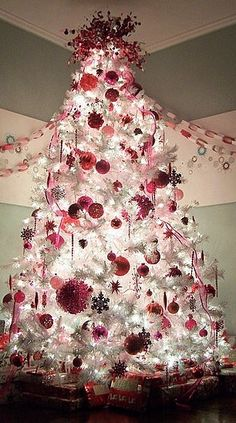Love this white tree with ornaments in shades of berry & silver.