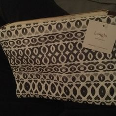 Bunglo Jessa Pouch Navy blue, off white, gray colors in this earthy zip top pouch.  Sold Out and was only available exclusively through Tory Burch Foundation. Bunglo Shay Spaniola Bags Cosmetic Bags & Cases