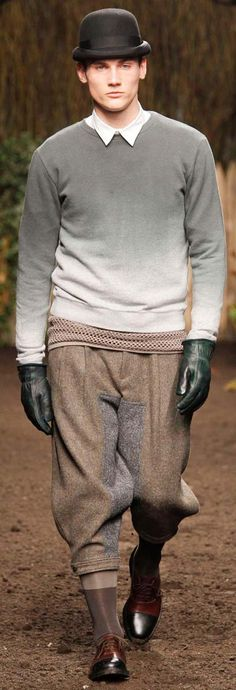 Robert Geller AUTUMN//WINTER 2012  Trousers are particularly standout. Grayscale pullover sweater is equally interesting