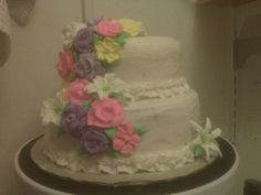 Two later iced cake with royal icing flowers