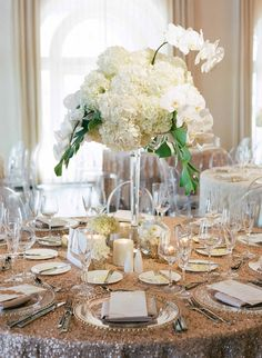 Image result for modern tropical wedding arrangements white orchids