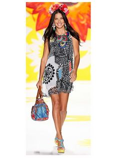 This printed dress is so much fun! Love the beaded and embroidered neckline on this dress by Desigual.