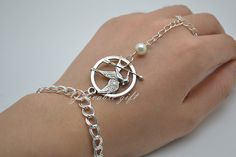 The Hunger Games Logo pendant antique silver Mockingjay Arrow and Peeta pearl bracelet and ring