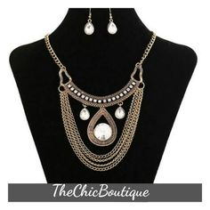 Stylish gold chain necklace with clear crystal earrings. Completes the look of any outfit.  #freeshipping | Shop this product here: http://spreesy.com/TheChicBoutique/1 | Shop all of our products at http://spreesy.com/TheChicBoutique    | Pinterest selling powered by Spreesy.com
