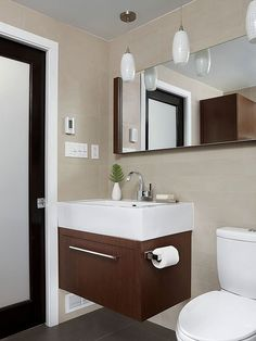 Make the most of a small bathroom with an integrated sink and wall-mounted vanity.