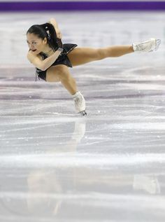 Akiko Suzuki of Japan skates in the women's short program at the World Figure Skating Championships in London, Ont., on Thursday, March 14, 2013.