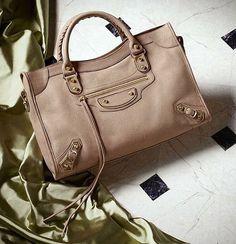 Wardrobe essential: neutral Balenciaga City bag. Shop now: brgdf.co/ShopIG