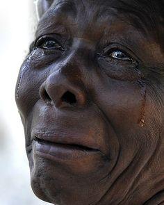 Haiti Weeps: Port au Prince Haiti. Published January 24, 2010. Washington Post. Washington, DC  http://mastersofphotography.wordpress.com/2012/03/29/carol-guzy/