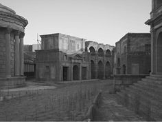 """""""In Sanctuary, the evident impermanence of the sets gives way to the slower impermanence of the Eternal City. Modern apartment blocks lurk over the shoulder of cardboard temples, and non-Romans may have moments of doubt as to whether some of the Roman buildings in Cinecittà are faked for film or are real remains seen beyond the borders of the studios."""" From a Review on Gregory Crewdsons Sactuary. http://francishodgson.com/2011/06/27/sanctuary-gregory-crewdson/#"""