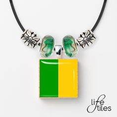 GAA County Team Lifetile Necklace - Green/Gold - Donegal, Kerry, Leitrim and Meath supporters can complement their team jersey. Green Necklace, Beaded Necklace, Irish Eyes Are Smiling, Erin Go Bragh, Irish Jewelry, Green And Gold, Celtic, Glass Beads, Ireland