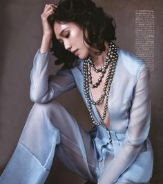 Model Tao Okamoto in Vogue Japan July 2015 wears silk organza jacket and trousers from the Atelier collection