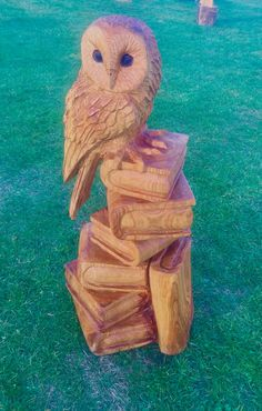 Chainsaw carved owl on books out of cherry
