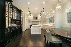 Black cabinets, white kitchen, dark wood floors