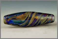 a handmade lampwork oval focal bead with by PolychromeBeads, $25.00