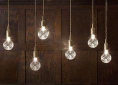 Asobi by Yasutoki Kariya Photos 1 - Swinging Lightbulb Installations pictures, photos, images