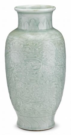 Chinese Longquan celadon vase chenghua mark, Qing dynasty The baluster form vase moulded with scrolling lotus motifs beneath green glaze, between lappet, keyfret and petal bands around neck and constricted foot. H: 13 3/4 inches
