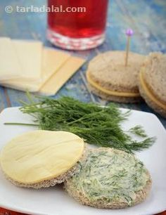 Oh-so-yummy describes these dainty Mini Cheese and Dill Sandwiches best. The creaminess brought about by soft butter and cheese is beautifully complemented by the fresh aroma and flavour of chopped dill. Indeed, this starter cum snack is a delight to behold and bite into.