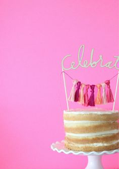Make this 'Celebrate' Tassel cake topper courtesy of Chelsea of http://brightbolddesign.com/