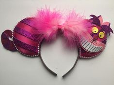 This is a pair of pink and purple Mickey ears inspired by the Cheshire Cat from Alice in Wonderland. Mickey Ears Info~ These ears are handmade by me! All my ears are the standard size you can find in Disneyland, so they will fit both adults and children! Because these ears are