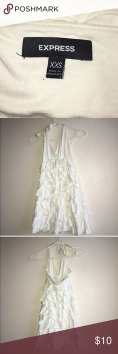 Express XXS White Halter Dress Trendy, tight, and white halter top Express dress is something to be desired! This extra extra small flirty dress with tiered ruffles is easily transitional to go from a summer barbecue to the winter snow bunny on the mountain! Express Dresses Mini