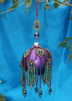 peacock ornament cover - link is dead Peacock Ornaments, Beaded Christmas Ornaments, Handmade Ornaments, Ball Ornaments, Handmade Christmas, Peacock Christmas Decorations, Clear Ornaments, Beaded Ornament Covers, Purple Christmas