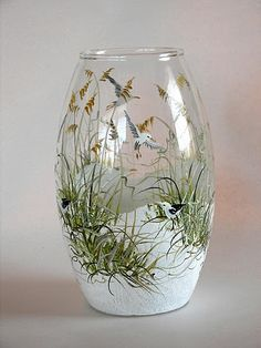 glass vase with beach scene - add some sand & a few pebbles & a small piece of driftwood from your favorite beach.