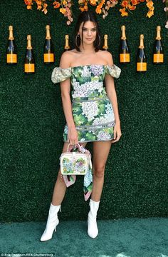 Party time: She was back in front of the camera just hours after posting her photography shots as she attended the Veuve Cliquot Polo Classic in Jersey City on Saturday