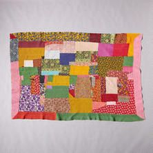 ONE-OF-A-KIND KURAVAM QUILTED THROW