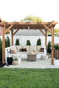 You don't need to travel far for a relaxing outdoor retreat. Turn your backyard into a beautiful oasis with one of these pergola ideas. We found free pergola plans, as well as fun decorating ideas for existing patio and porch covers. Backyard Gazebo, Backyard Seating, Backyard Patio Designs, Backyard Retreat, Backyard Pergola, Pergola Designs, Cozy Backyard, Diy Patio, Outdoor Pergola