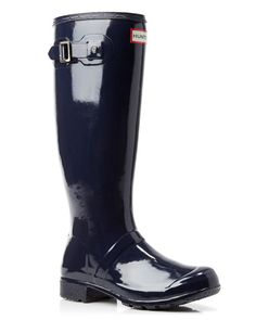 Hunter's classic rain boots are patently perfect (and packable!) with a glossy, high-shine finish and lightweight, foldable design. | Rubber upper, fabric lining, rubber sole | Imported | Fits large.