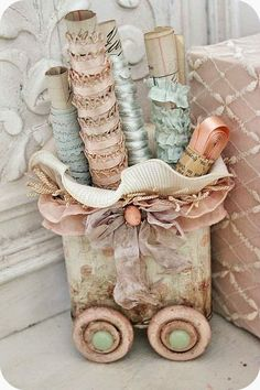 Painted wooden wheels added to an old repurposed tin - decorated with polka dots and lace. Easy storage display to hold little items like pens, brushes or even little bits of lace around vintage clothespins.
