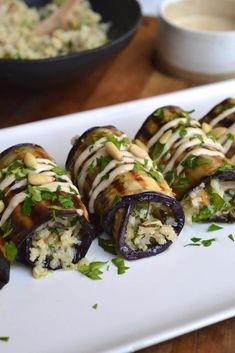 Herby Couscous Stuffed Eggplant Rolls A delicious herb cauliflower couscous with pine nuts and garlic wrapped in slices of grilled eggplant. Healthy Recipes, Veggie Recipes, Vegetarian Recipes, Cooking Recipes, Free Recipes, Healthy Eggplant Recipes, Stuffed Eggplant Recipes, Aperitivos Finger Food, Eggplant Rolls