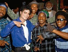 Michael throwing up a Crips sign with real Crips gang members.