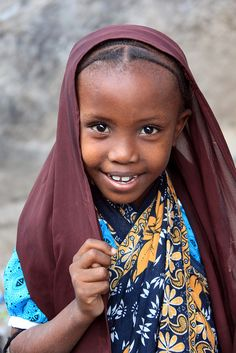 Girl in Maroon Hood by Rob Kroenert, via FlickrA girl on the street in Lamu, Kenya. In most of the country's touristy areas, it can be a struggle to get people to agree to have their photo taken without payment, but this girl and her friends were happy to pose and I really appreciated it. -