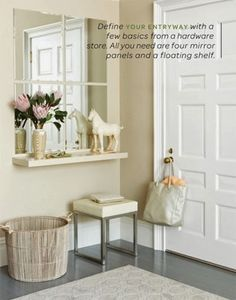 Create a foyer that does not exist by making a window effect with mirrors and a floating shelf. Seriously smart.