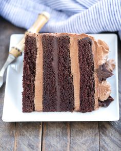 An exquisite 6 layer fudge cake filled with chocolate ganache and chocolate meringue buttercream frosting!